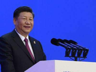 Xi Says China To Lower Trade Barriers As Beijing Files WTO Complaint Against U.S