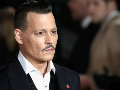 Johnny Depp Signs On To Star In Minamata