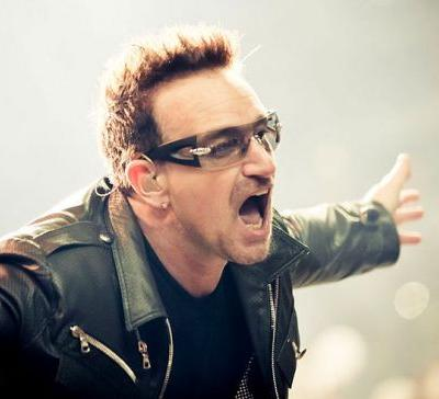 U2's Bono Uses Microphone In Front Of Statue of Liberty In Political Performance At 60th Grammy Awards