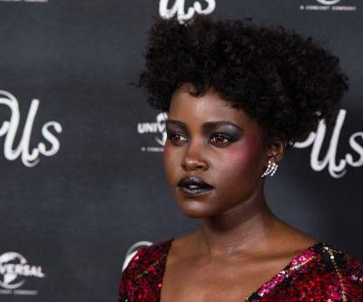 Lupita Nyong'o's Red Contacts Are The Stuff That Beauty Dreams Are Made Of