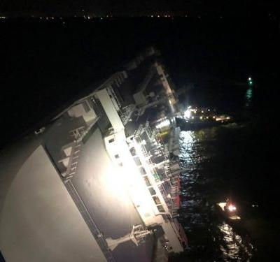 A massive cargo ship flipped over near a Georgia port, leaving 4 crew members missing