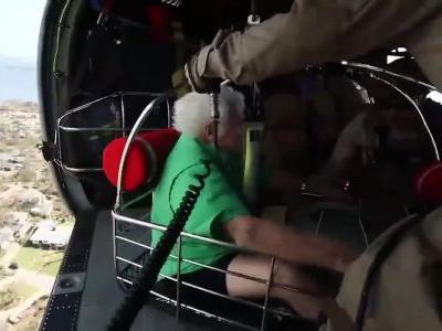 Rescued: Aircrew ventures deep into area heavily affected by Michael to save 2 people