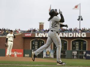 Pirates hit 3 HRs to back Nova in 10-5 win over Giants
