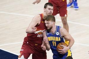 Nuggets close out 1st half with 113-103 win at Indiana