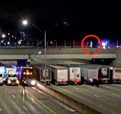 13 truck drivers came together to create a barricade with their vehicles to prevent a man from jumping off an overpass