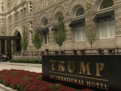 WATCH: Washington DC Police Officers Kneel With Protesters Outside of Trump Hotel