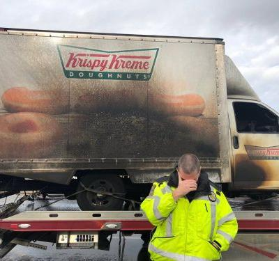 Police officers hilariously mourn loss of donuts after Krispy Kreme truck catches fire