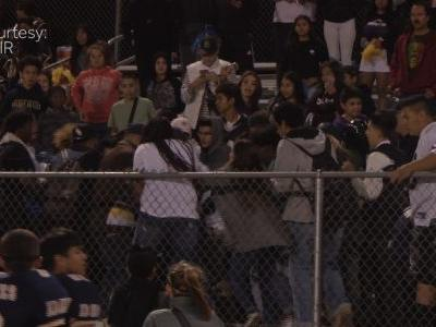 Football game forfeited after players join bleachers brawl