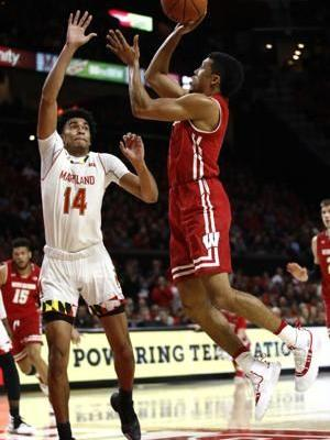 No. 19 Maryland squeezes past Wisconsin 64-60