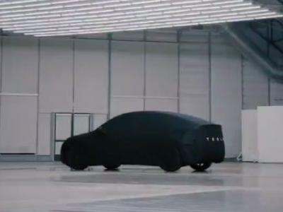 Here's the Tesla Model Y Under a Sheet: It's a Big Hatchback