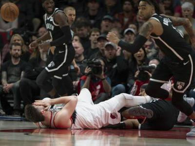 Jusuf Nurkic suffers devastating leg injury as his Blazers edge Nets in 2 OTs