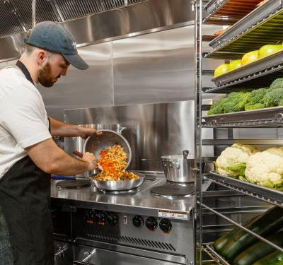 Petco is opening upscale kitchens in its stores where chefs will prepare human-grade meals for dogs - take a look inside