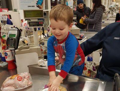 Tesco cashier jumps in to help soothe a three-year-old boy with autism