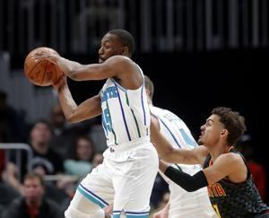 Walker, Williams lead Hornets past Hawks, 129-120