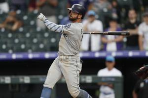 Padres edge Rockies in another slugfest at Coors Field