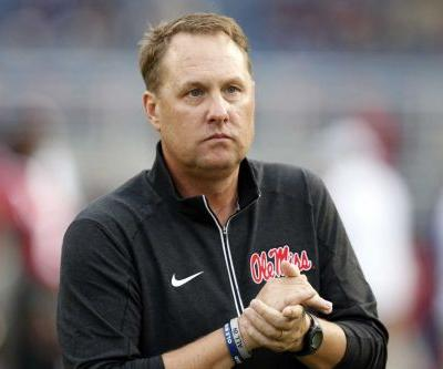 AP source: Liberty hired Hugh Freeze as football coach