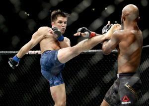 The Latest: VanZant wins first UFC fight in 2½ years