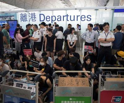 Hong Kong airport cancels flights again amid protester takeover