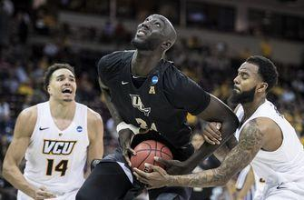 NCAA Latest: Tacko-Zion matchup highlights 2nd round games