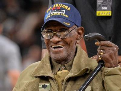America's oldest living WWII veteran just turned 112 - and he smokes 12 cigars a day