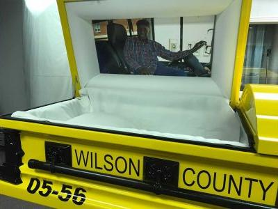A beloved school bus driver was laid to rest in a custom casket that looks like a school bus