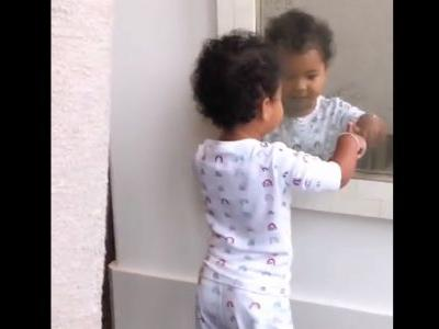 True Thompson Playing Peek-a-Boo With Herself in the Mirror is All the Cuteness You Need to Get Through the Week