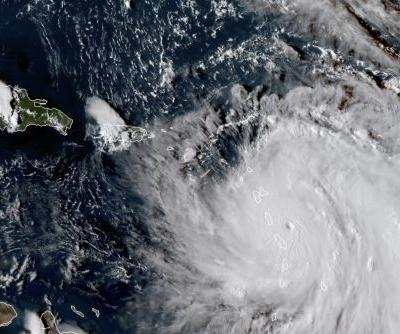 Hurricane Maria heads for Irma-damaged areas as a Category 5 storm