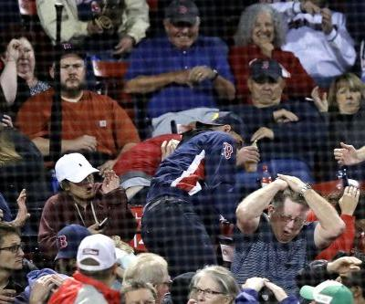 Red Sox fan taken on a stretcher after getting hit by flying bat