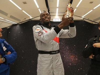 Usain Bolt Popped Champagne With an Astronaut in Zero Gravity