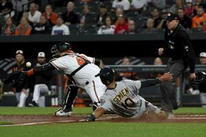 Khris Davis hits 2 HRs, Chris Davis hitless, A's thump O's