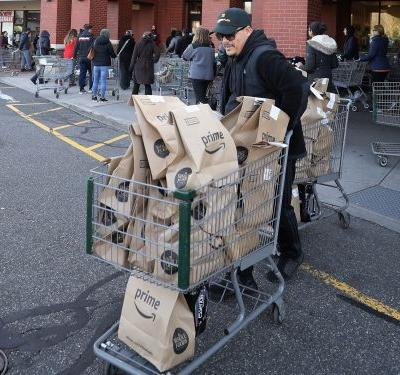'It's like being in a sci-fi nightmare film': Whole Foods employees say Amazon workers are crowding stores, ignoring virus protocols, and hounding them for help as online orders surge