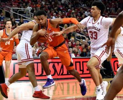 No. 16 Louisville avoids late disaster, beats Clemson 56-55