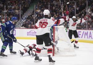Devils score 2 quick goals, hold on to beat Canucks 2-1