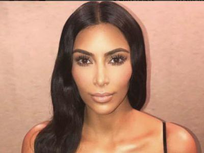A Bikini-Clad Kim Kardashian Gets Distracted by Her Reflection -and We Don't Blame Her!