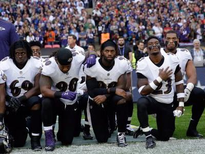 Ravens and Jaguars players kneel and lock arms during the national anthem in wake of Trump's comments