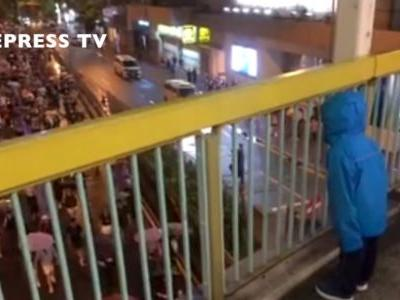 An adorable video shows a Hong Kong child leading streams of protesters in a chant: 'Hong Kong people, keep going!'
