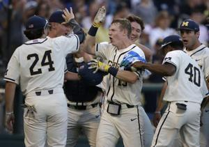 Michigan beats Vandy 7-4; 1st title since '62 is 1 win away