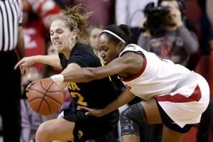 Gustafson's 20-20 effort leads No. 12 Iowa past Nebraska