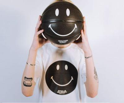 Caliroots Joins Chinatown Market for Glow-in-the-Dark Smiley Gear