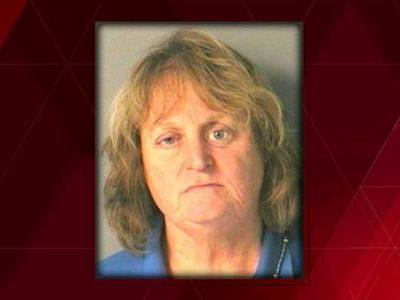 Woman accused of pushing her dog into lake, watching it drown