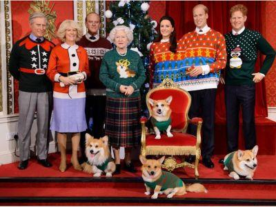 These wax versions of the Royal Family are dresed in ugly Christmas sweaters - even the corgis