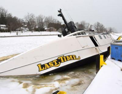 WELL IT HAPPENED.ONE OF THE TWO BAYFIELD FISHING BOATS HAS PARTIALLY SUNK!!