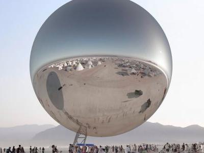 People at Burning Man are fascinated by this enormous, shiny orb