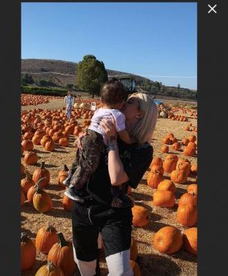 These Photos Of Kylie Jenner, Travis Scott, & Stormi Pumpkin Picking Are Too Adorable