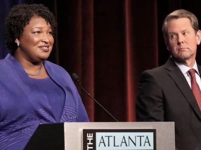 Stacey Abrams says Brian Kemp will beat her in the Georgia governor's race, but calls his 'voter suppression' tactics 'appalling'