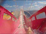 Incredible footage shows rider twisting and turning along the world's longest water slide at sea