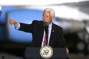Pence to keep up travel despite contact with infected aide