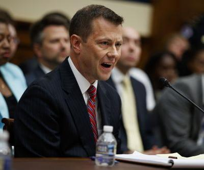 FBI agent angrily rejects charges of bias at chaotic hearing