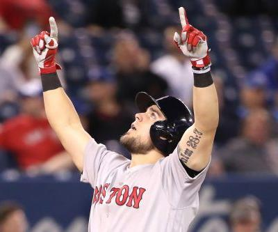 Rookie's homer in 13th helps Red Sox get some rest