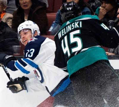 Connor, Hellebuyck propel Jets to 3-0 win over Ducks